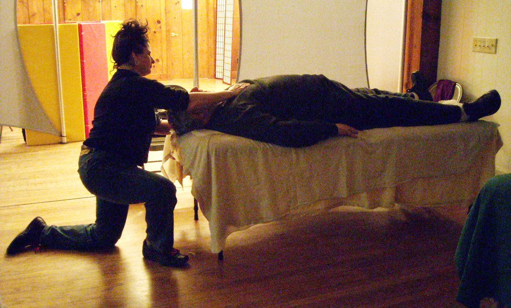 Jesse Scherer practices massage on a patient during Rondout Valley Holistic Health Community's January event.