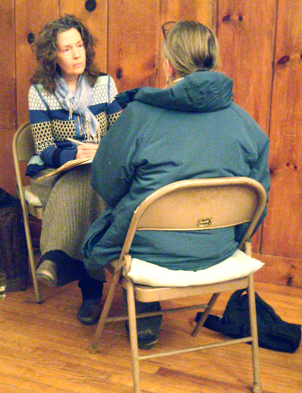 Practitioner Katy Bray speaks with a patient. Volunteers skilled in lesser-known health modalities such as Integral Homeopathics (pictured above), Soul Listening, and Plant Spirit Healing offer participants the chance to experience new holistic therapies.