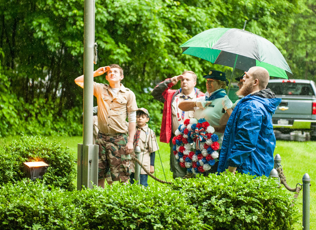 Boy Scouts Evan Fairbrother, Rylan Peterson, Eric Dewitt, Christian Magana and Bob Howe solemnly raise the flag during the Rosendale Memorial Day ceremony.