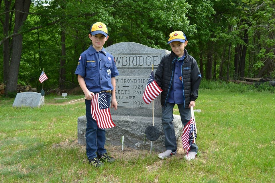 Cub Scout and Boy Scout Troop 16 and mem­bers of Marbletown American Legion Post 1512 conducted their reverent activity of the decoration of local graves on May 20 in recognition of Memorial Day. Photo of Jayden Harris and Joseph Sweeney.