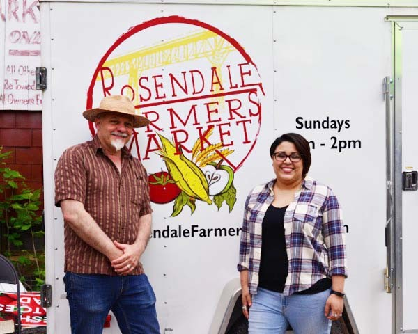 Sean Nixon, Design Program instructor at SUNY Ulster, and Liz Galeano, student and designer of  the new Rosendale Farmers Market Logo, on opening day.