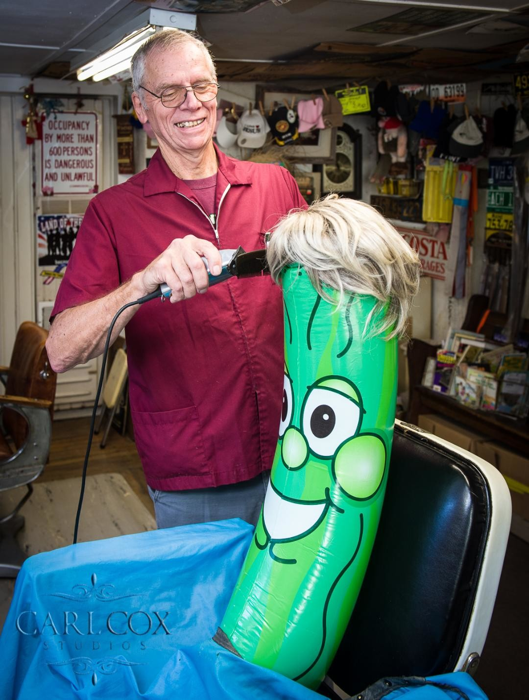 Bill Brooks gives Mr. Pickle a trim in preparation for the Pickle Fest event.
