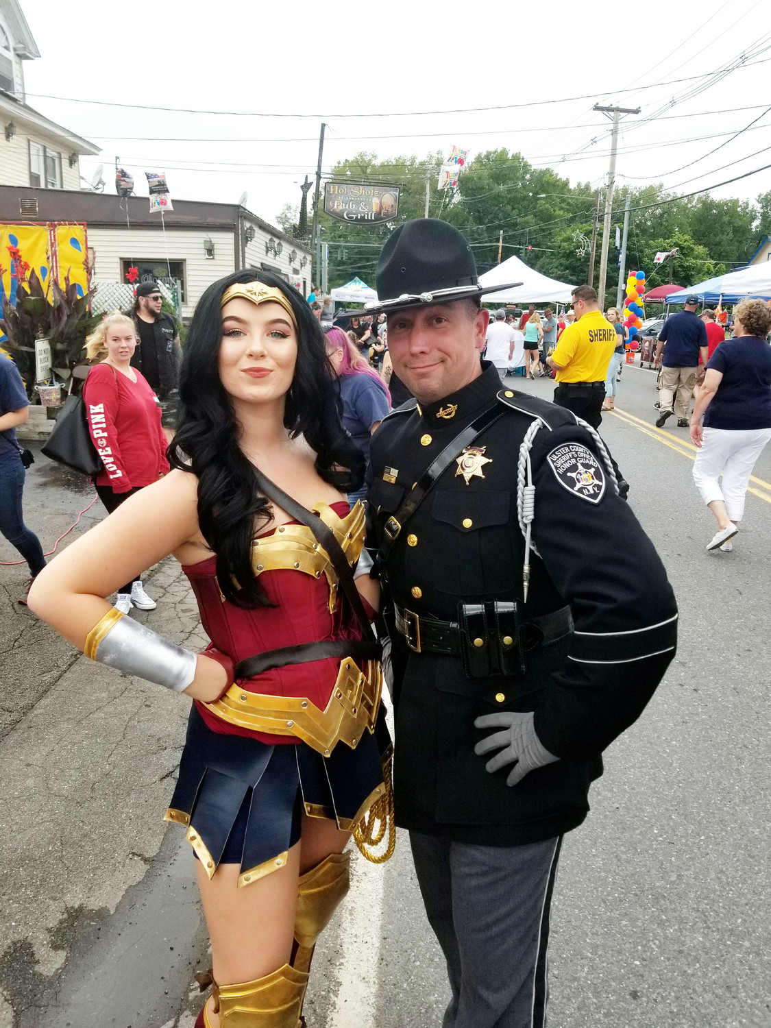 FSO Officer George Hill of the Ulster County Sheriff's Department poses with fellow superhero, Wonder Woman.