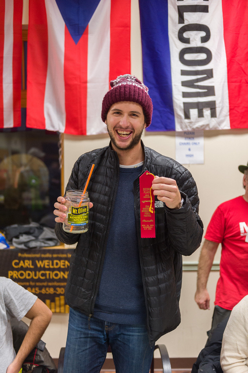 Drink up! The annual pickle juice drinking contest second place winner pictured here, Dominic Demeterfi, a Vassar College student