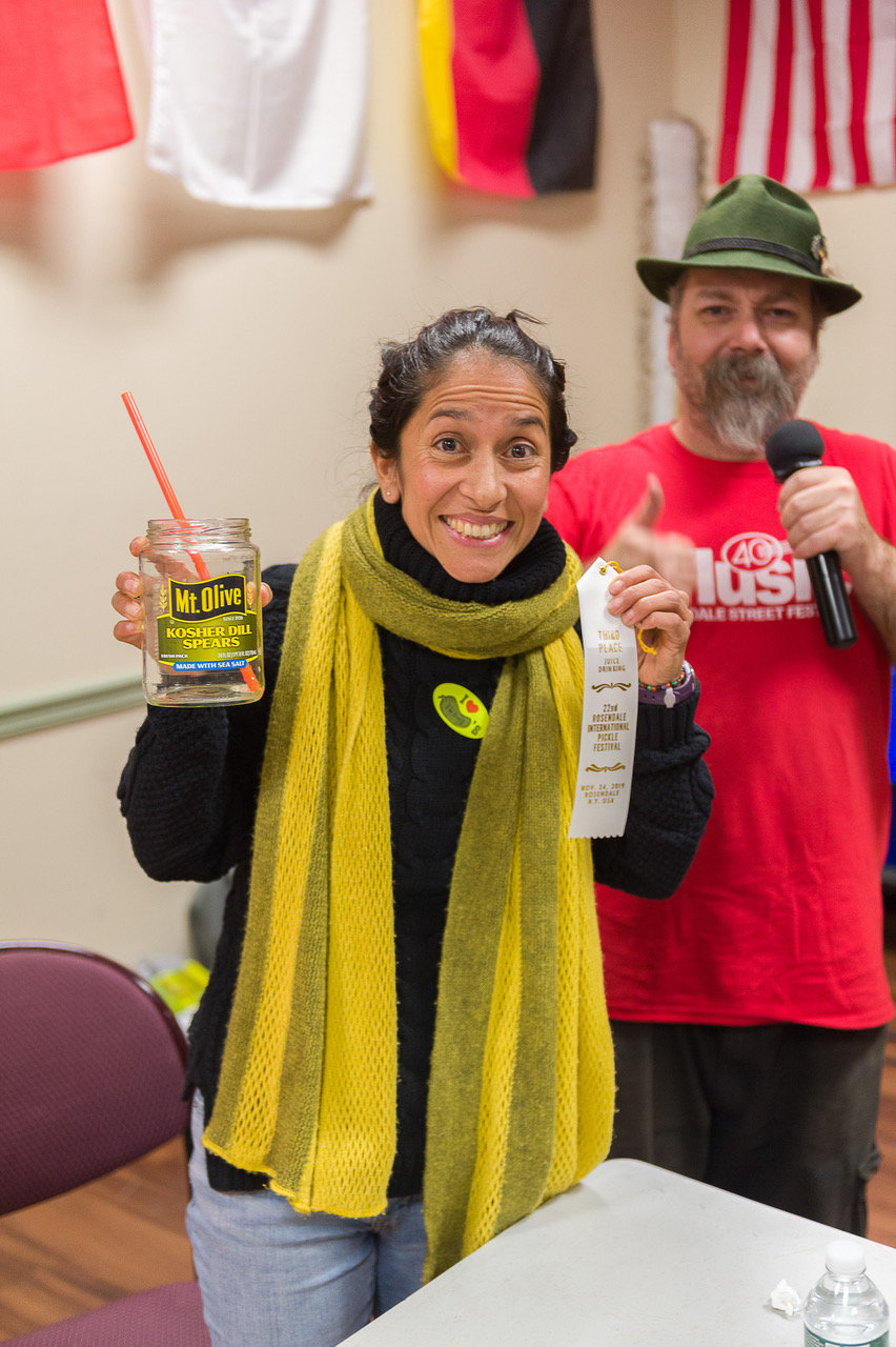 Drink up! The annual pickle juice drinking contest third place winner, Rosibel Camdau, of Rosendale.
