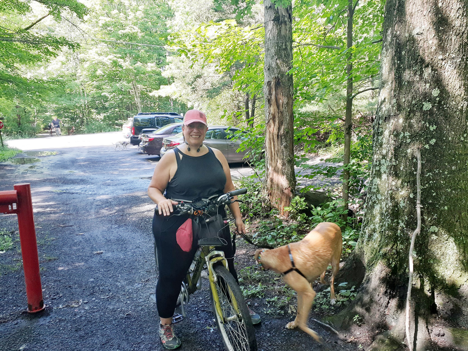 Lisa McGovern and Rocket at the Marcotte Road trailhead. Special posted rules include, stay 6' away, keep to the right, do not block trail, pass on the left and try not to touch surfaces.