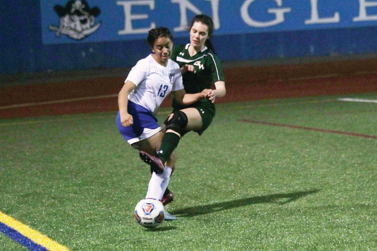 Englewood's Sierra Mazur battles a George Washington player for possession of the ball during the March 17 non-league soccer game. Mazur score Englewood's only goal and, while both teams played well, the Patriots aggressive attack was the difference as GW posted a 4-1 win.