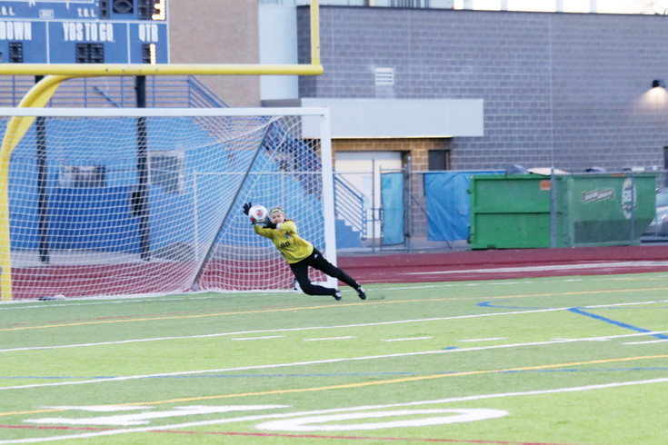 Englewood goalie Hannah Drolshagen makes a diving save on a shot from a George Washington attacker during the March 17 non-league girls soccer game. The Pirates played good soccer and Drolshagen made six saves but GW won the game, 4-1.