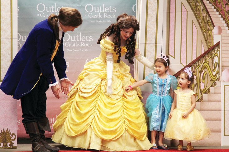 Camry Felton, 5, and Caiya Felton, 2, of Castle Rock meet Belle and the Prince for photos on March 18.