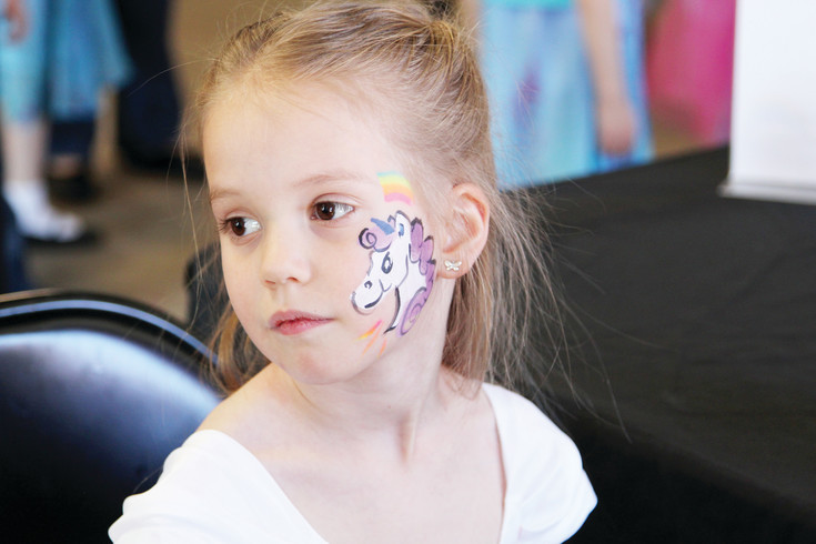 Bella Colella, 5, of Larkspur, has a unicorn painted on her face while at a tea party during Princess Week.