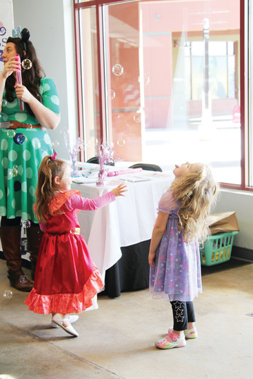 Ivy Haegar, 3, catches bubbles on her tongue at a tea party on March 18 for the Outlets at Castle Rock Princess Week.