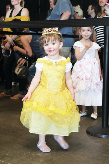 Khyla Zinkula, 2, strikes a pose in her costume while waiting in line to meet Belle.