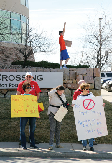Protesters gathered outside the Castle Rock office of Congressman Ken Buck on March 22, a day before the anticipated vote to repeal the Affordable Care Act.