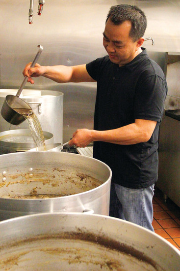 Chanh Nguyen ladles out a bit of the beefy broth he's steeping in the kitchen at Hashtag Pho in Centennial. Nguyen came to the United States in 1987 and opened his family's first pho restaurant near County Line and Quebec over 15 years ago.