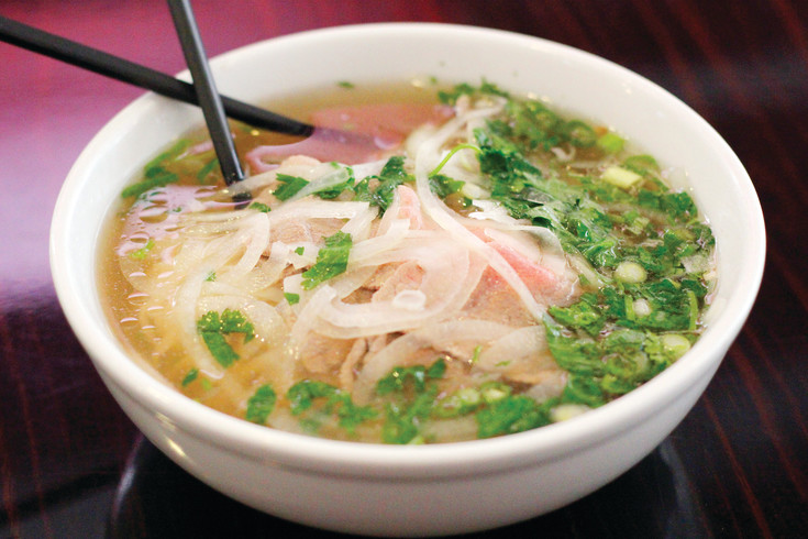 A steamy bowl of pho awaits comsumption on a table inside Pho Real in downtown Littleton. Manager Sunny Wong says the restaurant goes through 20 to 25 gallons of the broth-based dish on an average day.