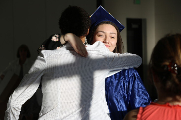 Rocky Mountain Deaf School senior Victoria Ponce de Leon receives a hug after the school's graduation on May 31. Ponce de Leon was the class speaker during the ceremony, and also received a scholarship to help her pay for college.