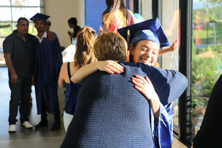 Rocky Mountain Deaf School senior Daisy VanMeter receives a hug after the school's graduation on May 31.