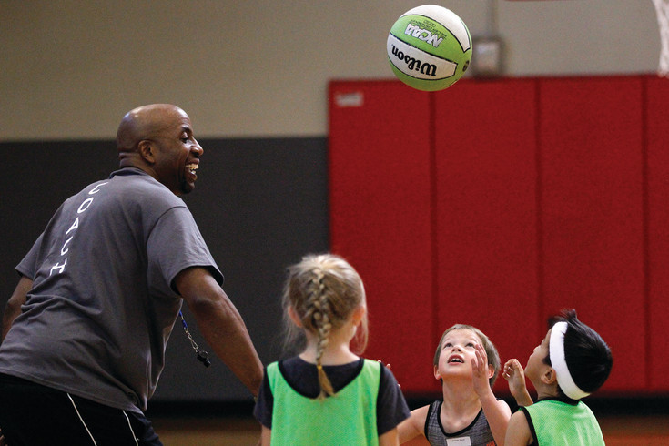 Chauncey Billups Basketball Academy Coach Carey Whitford flings a jump ball to his players in a scrimmage at the Parker Fieldhouse. Children between the ages of 6 and 17 attended the camp, now in its seventh year at the Parker Fieldhouse.