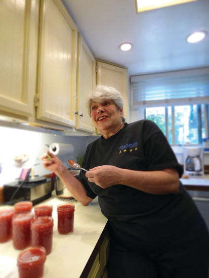 Joanne Littau tells tales of her younger days in New York while finishing off a batch of strawberry rhubarb jam.