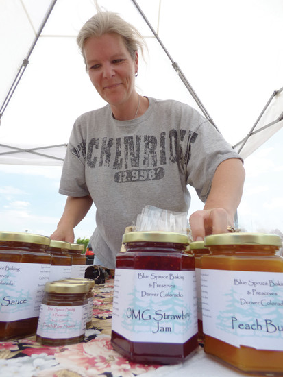 Dorreen Strnad stocks her stand with homemade jam.