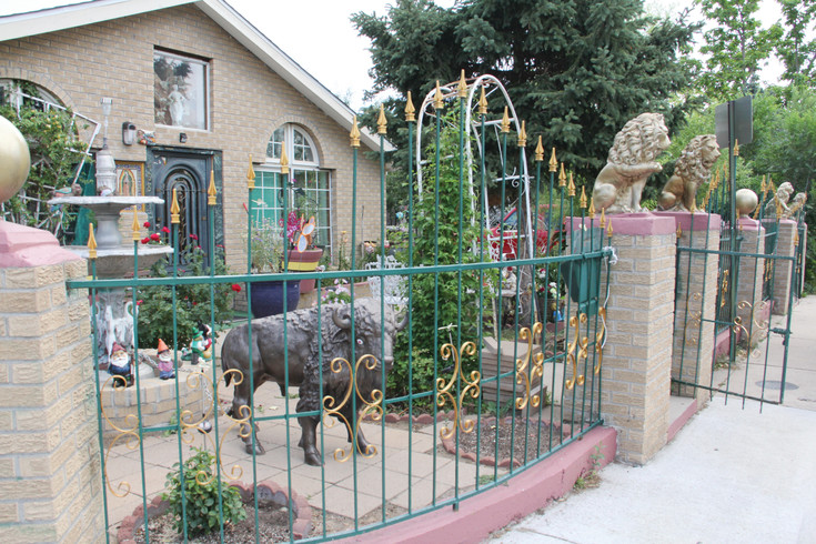 The front yard of Graciela Javalera's house July 6, 2017, in the Westwood neighborhood just north of Morrison Road, where Denver has planned to create a cultural and business district. Javalera, 72, collected ornaments for her yard for years at flea market stores. The iron gate is emblematic of Mexican culture, a common sight in the area.