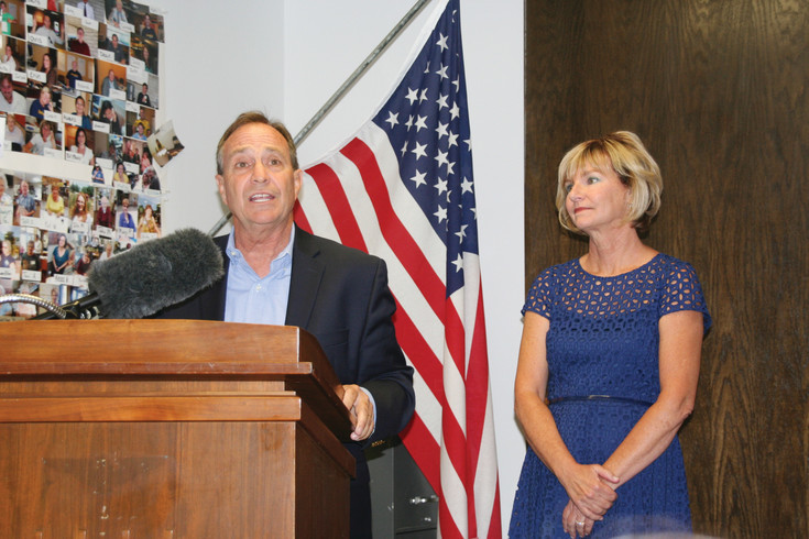 Nancy Perlmutter, right, listens as her husband, U.S. Rep. Ed Perlmutter (D), left, announces his decision to drop out of the Colorado governor's race during a press conference on July 11 in Perlmutter's office in the Applewood Tech Center.