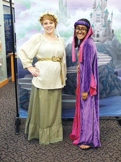Rasika Mukkamala, right, stands besde fellow volunteer Hannah McClintock during the Fairytale Ball at the James H. LaRue Library in Highlands Ranch in September 2016. Mukkamala says she enjoyed community events and services as a child and volunteering allows her to give that opportunity to other children. Courtesy photo