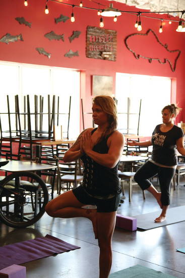 Ally Fleckenstein participates in Yoga in the Taproom at Odyssey Beerwerks.