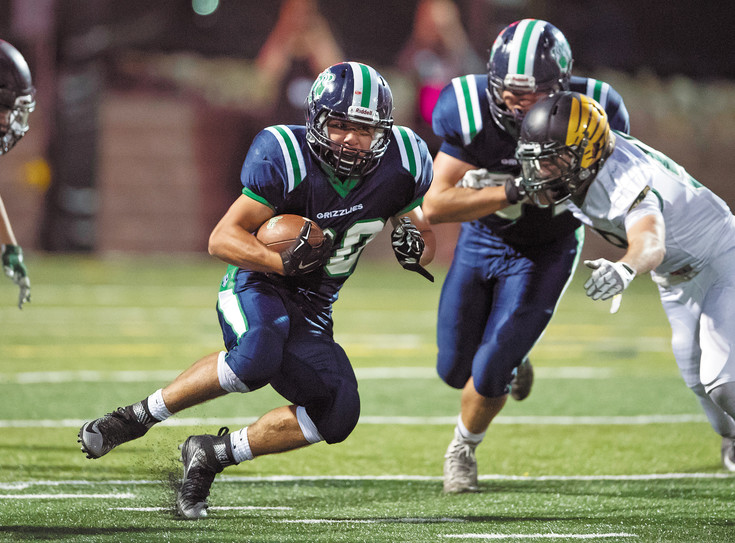 ThunderRidge's Zeke Johnson (30)  makes a cut to avoid a Mountain Vista defender in last year's rivalry game. ThunderRidge won 35-13.