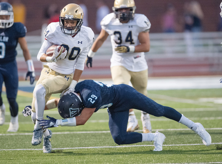 Valor Christian's Chase Lopez (29) gets underneath Mullen's Wind Henderson (80).  The Eagles got their second victory of the season over Mullen 34-7 on Sept. 1 at Valor Stadium.
