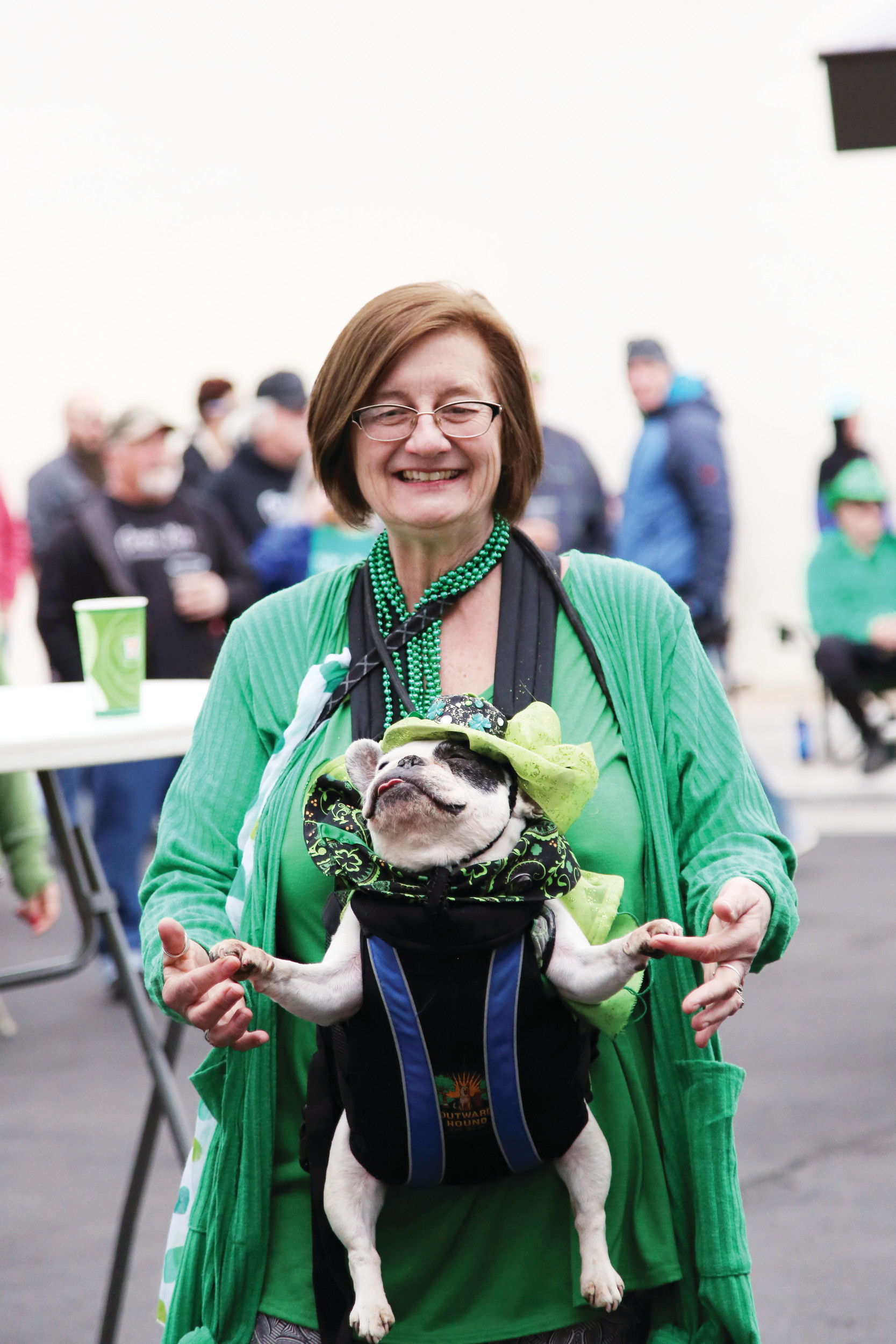 Marleen Pucak and her dog, Beignet, take to the dance floor at the Olde Town Arvada St. Patrick's Day Festival.