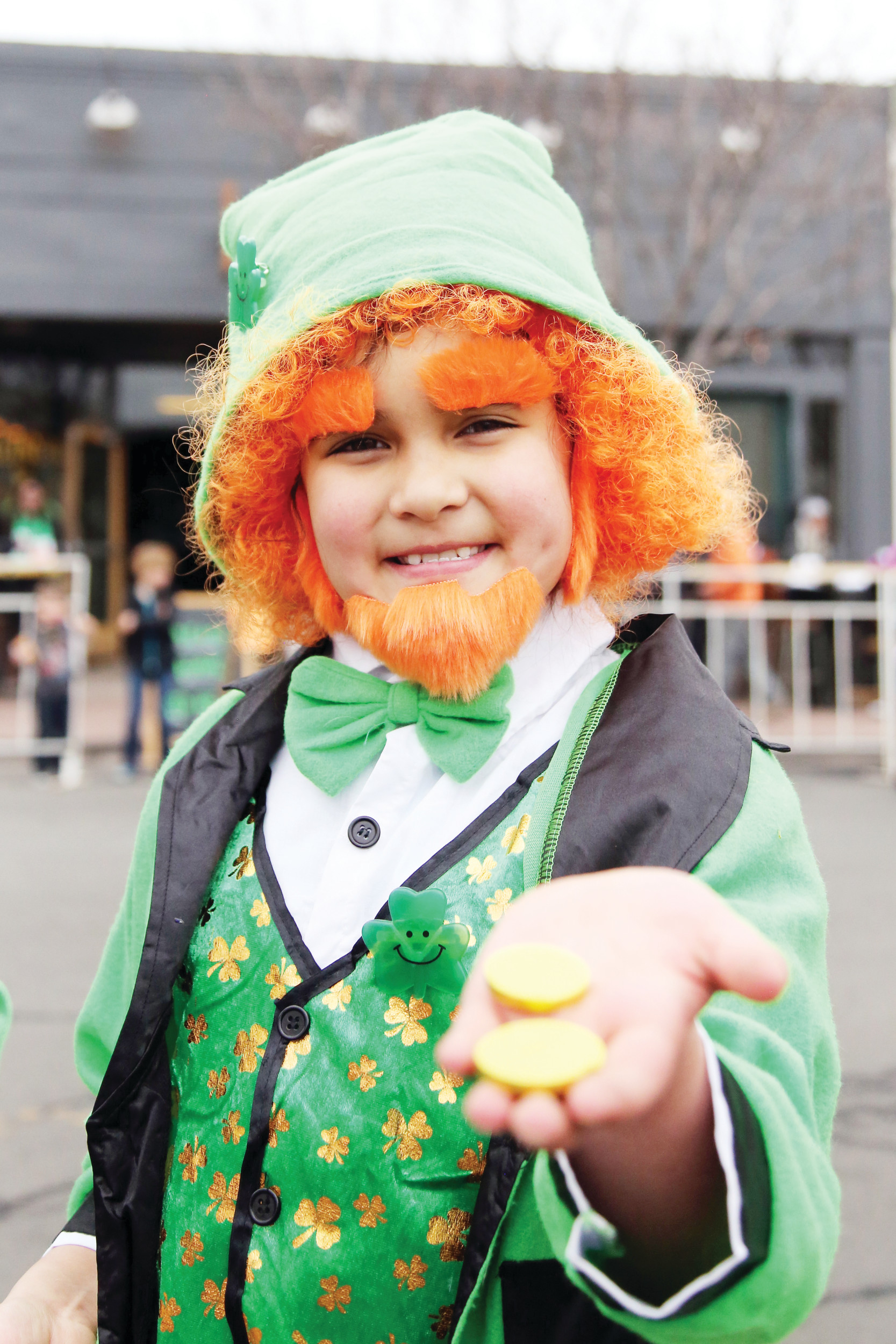 Eva Torres, 10, dressed an a leprechaun and gave out gold coins during the St. Patrick's Day Festival.