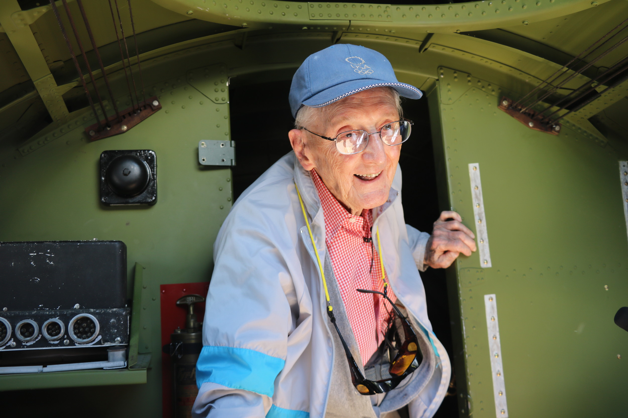 World War II veteran Robert McAdam, 96, of Highlands Ranch, climbs through the Madras Maiden B-17 bomber during its visit to the Rocky Mountain Metro Airport.