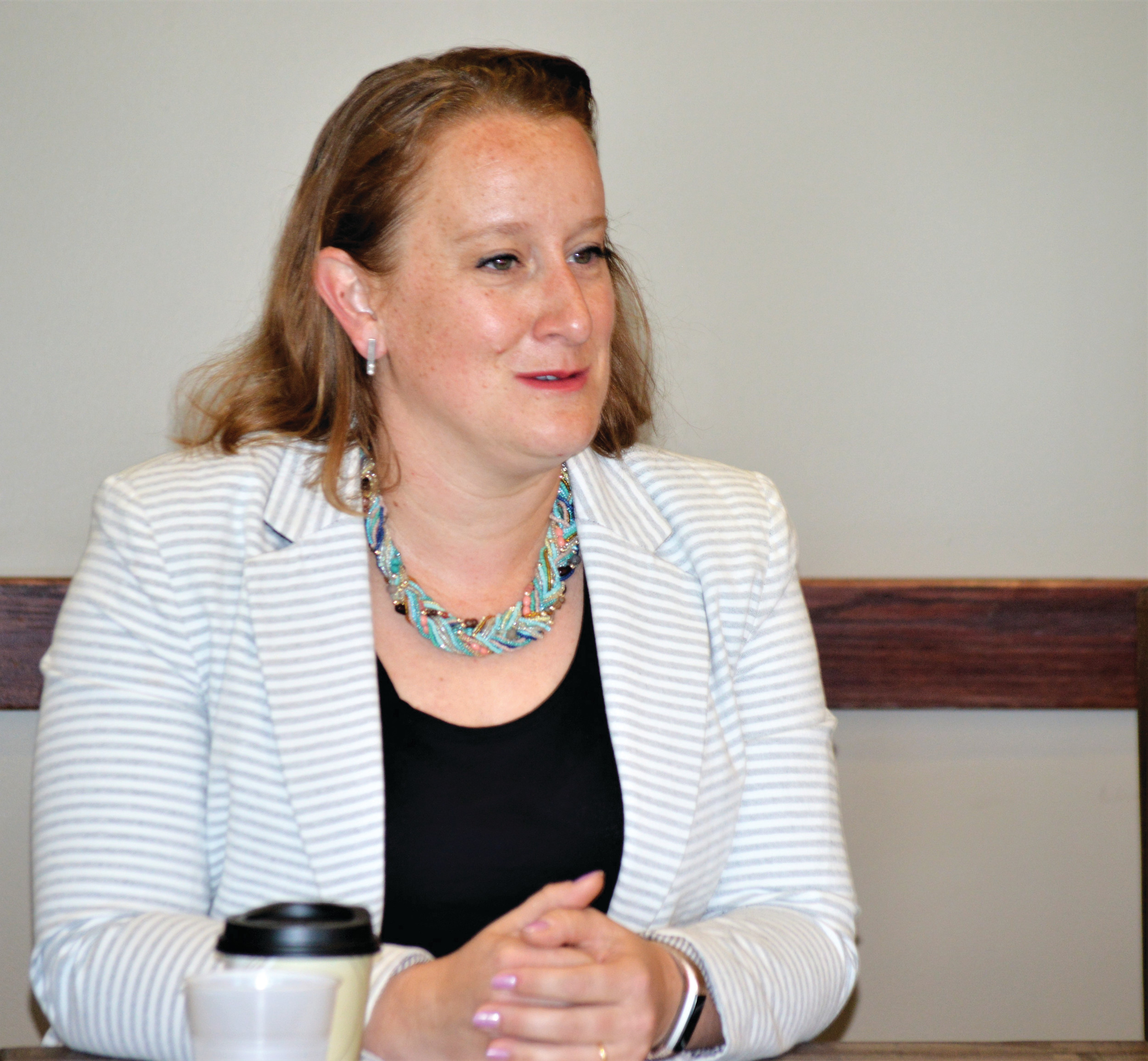 City Councilor Emma  Pinter speaks at the Jeff-West Community Forum Aug. 25. Pinter is seeking reelection to her seat.