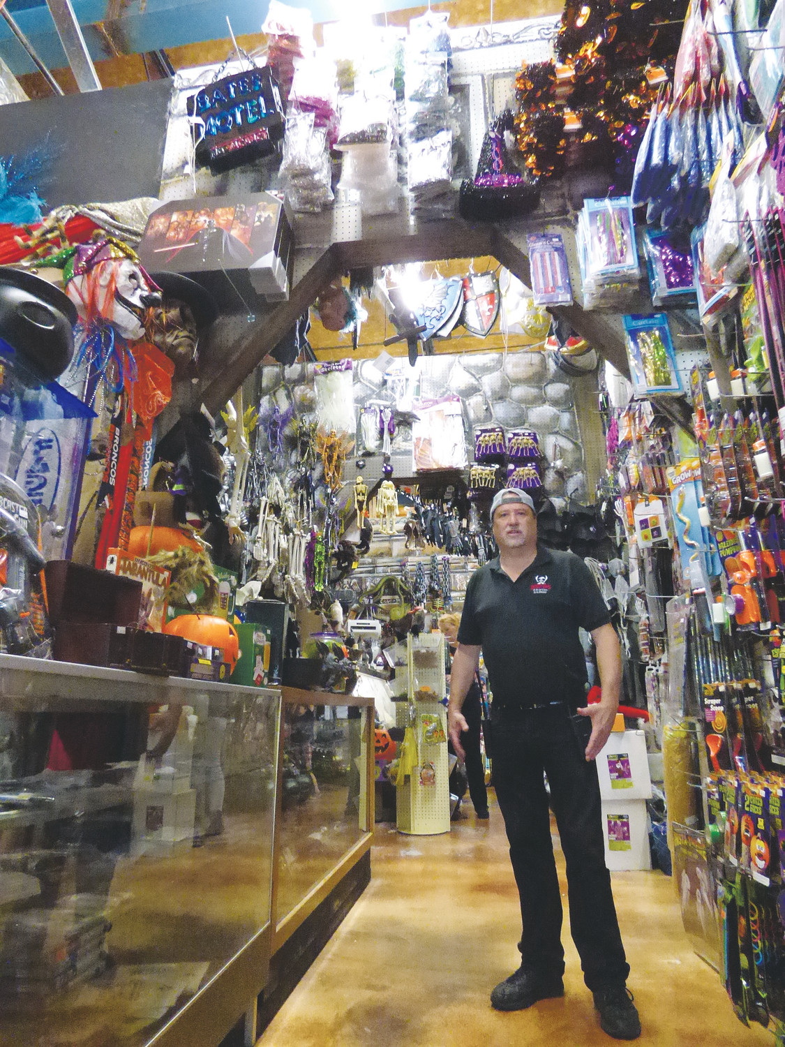 Reinke Bros. owner Greg Reinke shows off one of the recently renovated portions of his wild and wacky costume and prop shop. His famous haunted house is slated to re-open next year.