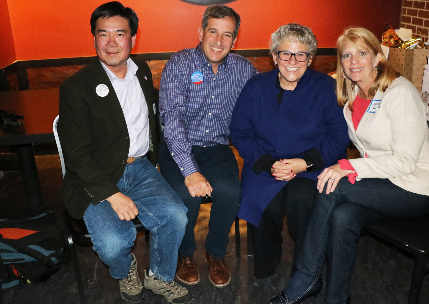 """commUNITY"" candidates, from left, Kevin Leung, Anthony Graziano, Chris Schor and Krista Holtzmann, celebrate their victory in the Douglas County School Board election at a viewing party on Nov. 7 at On the Rox near Lincoln Avenue and I-25. Photo by Alex DeWind"