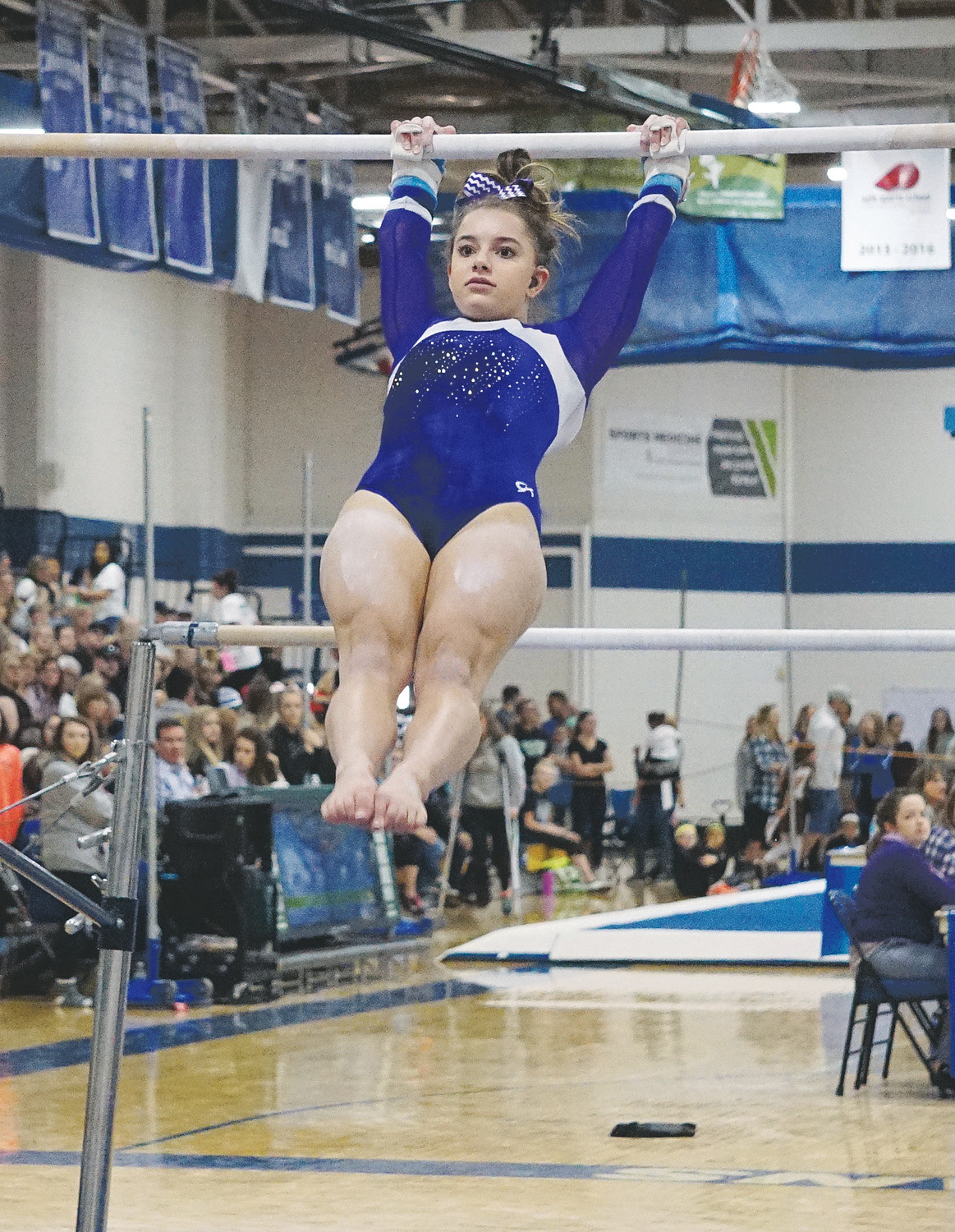 Arvada West senior Shaye Mathais competes on the uneven bars during the Class 5A state event finals Nov. 4 at Thornton High School. Mathais won the 5A beam event in her final routine of her prep gymnastics career.