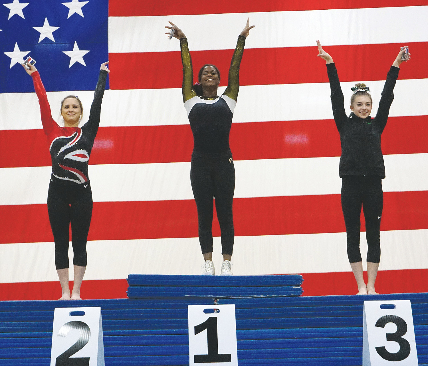 Green Mountain senior Ramya Sinha, middle, stands atop the podium during the award ceremony of the Class 4A vault winners Nov. 4 at Thornton High School. Sinha also placed second in the uneven bars and took third in the 4A all-around competition.