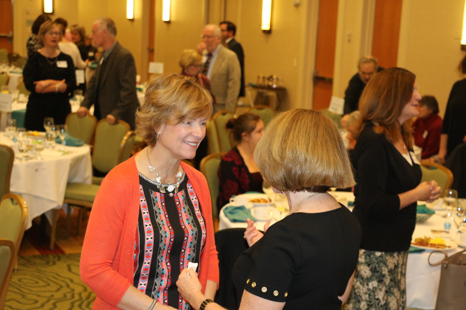 Christine White visits with friends after the Celebrate Women of Jefferson County event on Nov. 17 at the Denver Marriott West.