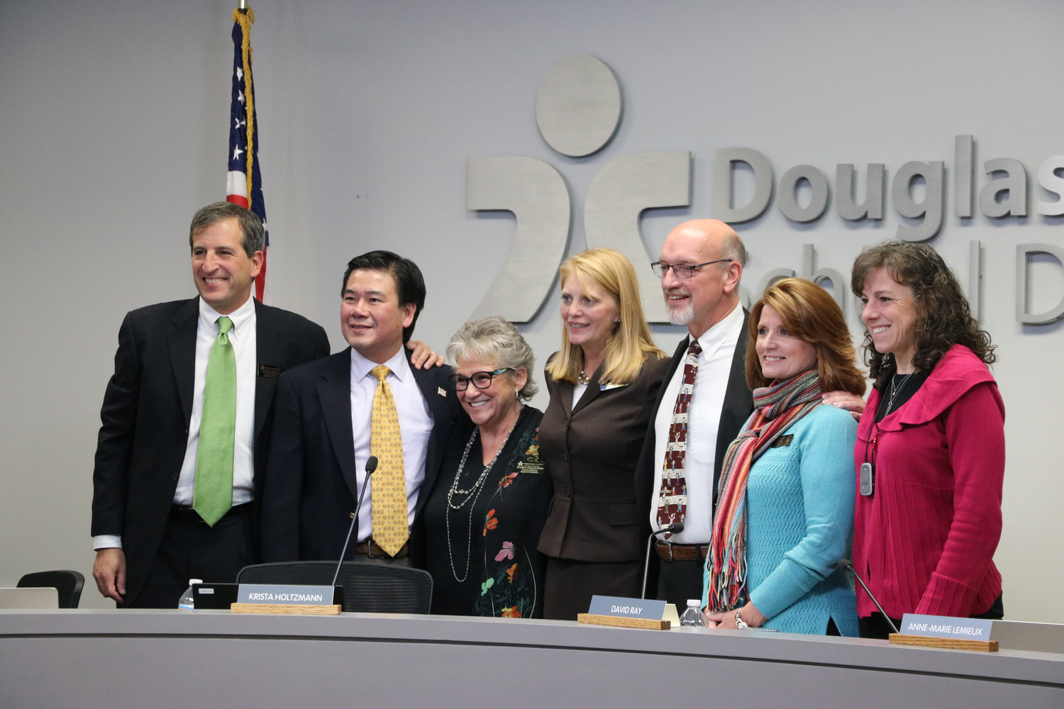Anthony Graziano, left, Kevin Leung, Chris Schor, Krista Holtzmann, David Ray, Anne-Marie Lemieux and Wendy Vogel stand as the new Douglas County School Board at a Nov. 28 board meeting in Castle Rock.