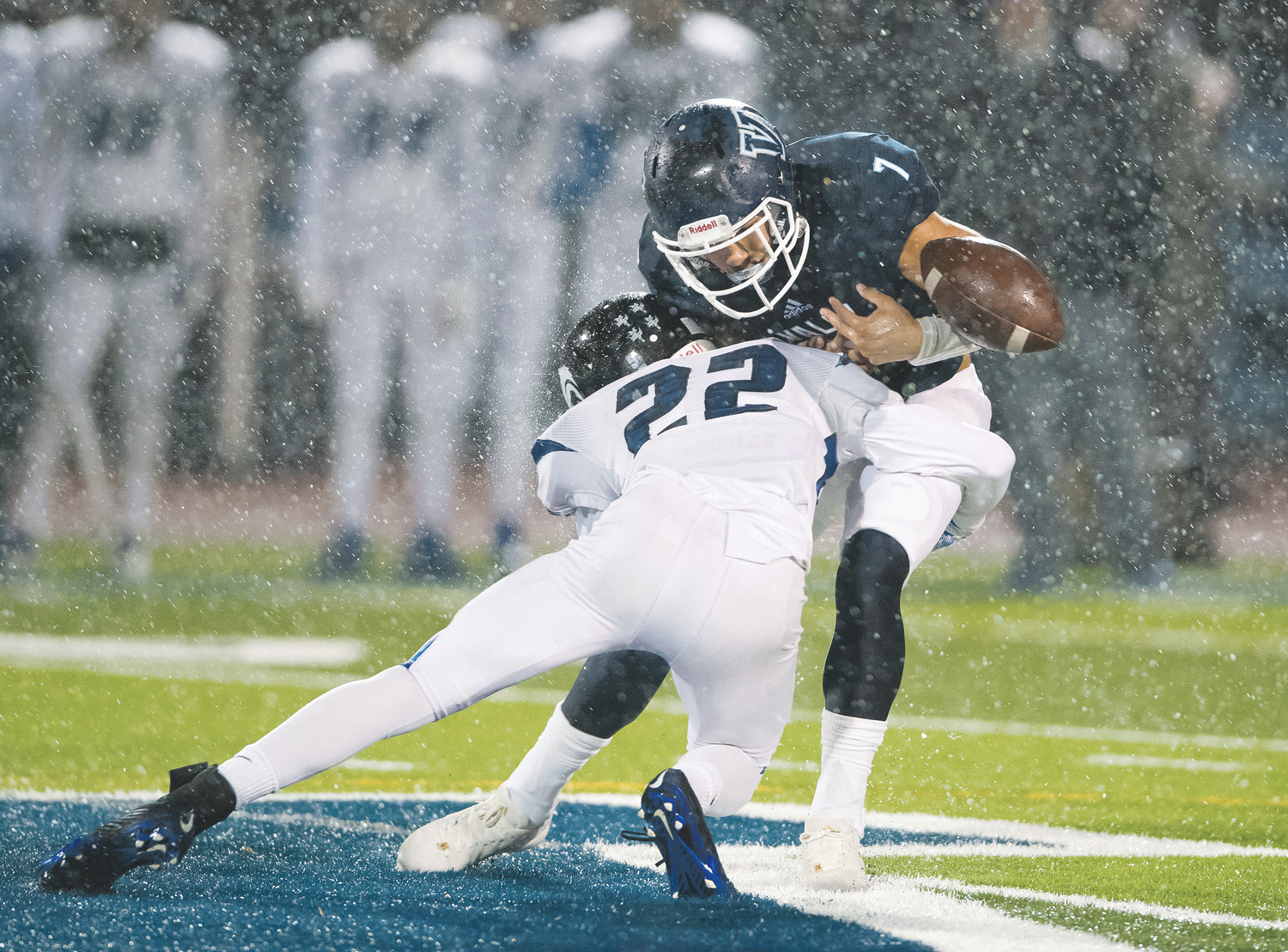 Extremely bad conditions made holding onto the ball a challenge for Valor Christian's Joshiah Davis (7) as Grandview's Trevor Greenlee (22) levels a solid hit.    Davis managed 70 yards on 20 carries on a wet, soggy field Friday night at Valor Stadium as the Eagles were eliminated from the playoffs 28-16.  This year will mark the first time Valor will not play in a State Championship since 2008.