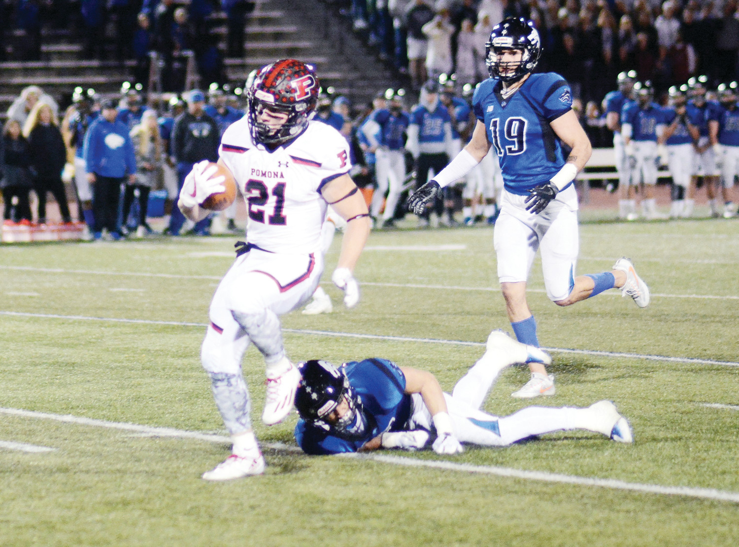 Pomona senior running back Max Borghi (21) breaks free during his first of three touchdown runs during the Class 5A football state semifinal against Grandview on Nov. 25 at Legacy Stadium in Aurora. Borghi finished the night with 18 carries for 211 yards in the Panthers 42-20 victory.