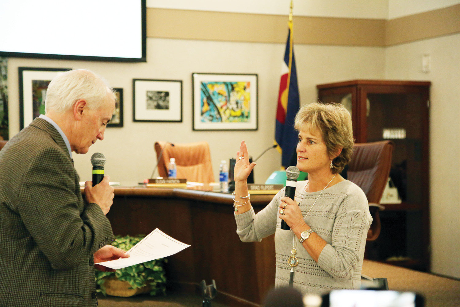 Susan Harmon is sworn in for another four years serving on the Board of Education for Jefferson County Public Schools at a special meeting on Nov. 27.