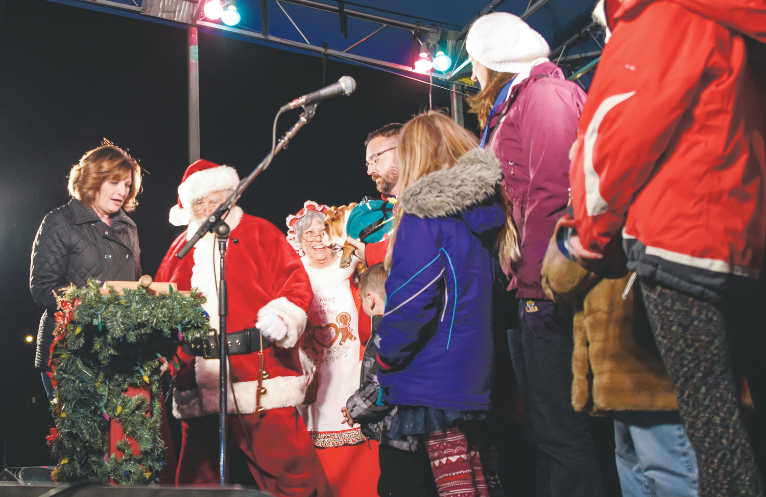 Thornton Mayor Heidi Williams, left, and Santa Claus get ready to  turn on the Christmas lights, officially opening this year's Thornton Winter Fest, Friday, Dec. 8 at Carpenter Park.