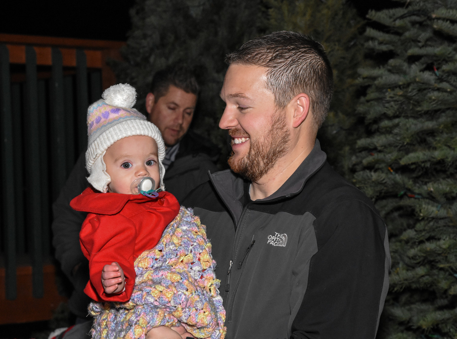 Curtis Kelly, right, and daughter Alexis, 1, of Brighton, await their turn to see Santa Claus at this year's Thornton WinterFest, Friday, Dec. 8 at Carpenter Park.
