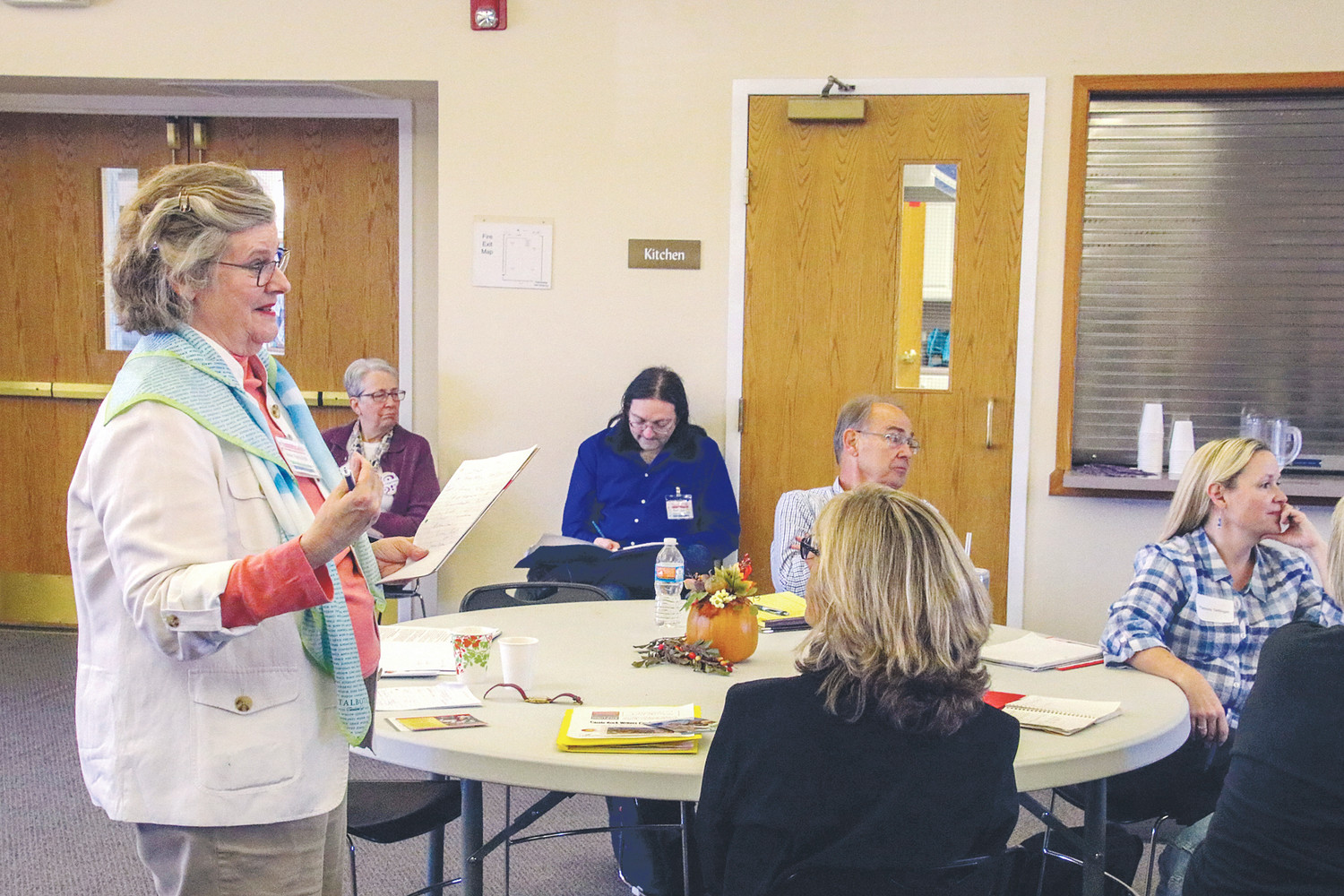 "Anne Randolph, founder of Kitchen Table Writing, teaches ""Raising the Stakes with Conflict"" at a Castle Rock Writers gathering."
