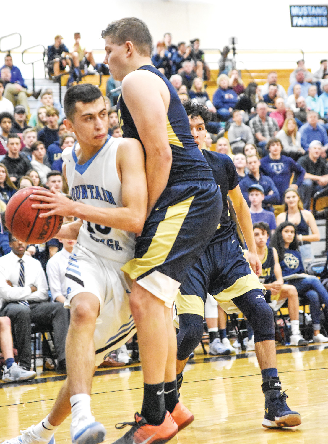 Legacy's Austin Mullins, right, defends Mountain Range guard Brandon Romero, during the season opener for both teams, Wednesday, November 29, 2017, at Mountain Range High School in Westminster. Mountain Range came back from a 17-point halftime deficit, only to lose in overtime, 72-70.