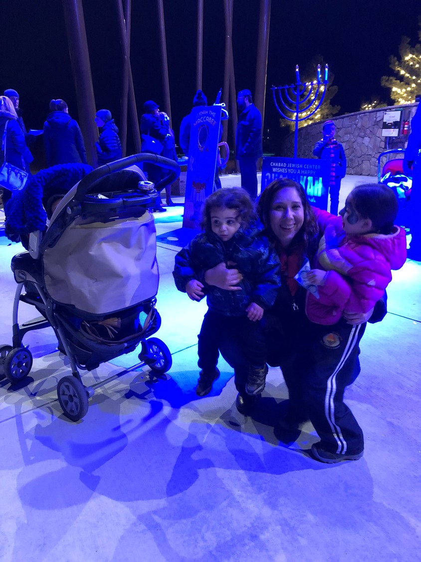 Natalia Henley attended a public menorah lighting with her three children at the Philip S. Miller Park Amphitheater in Castle Rock on Dec. 13.