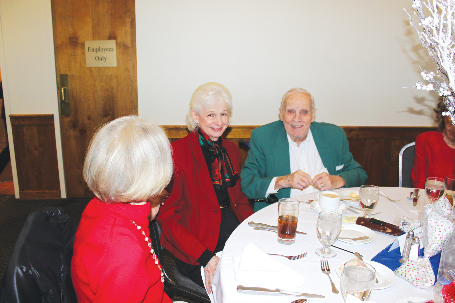 Judy and Bill Robertson visit with friends during the Living and Aging Well holiday luncheon at the Lone Tree Country Club.