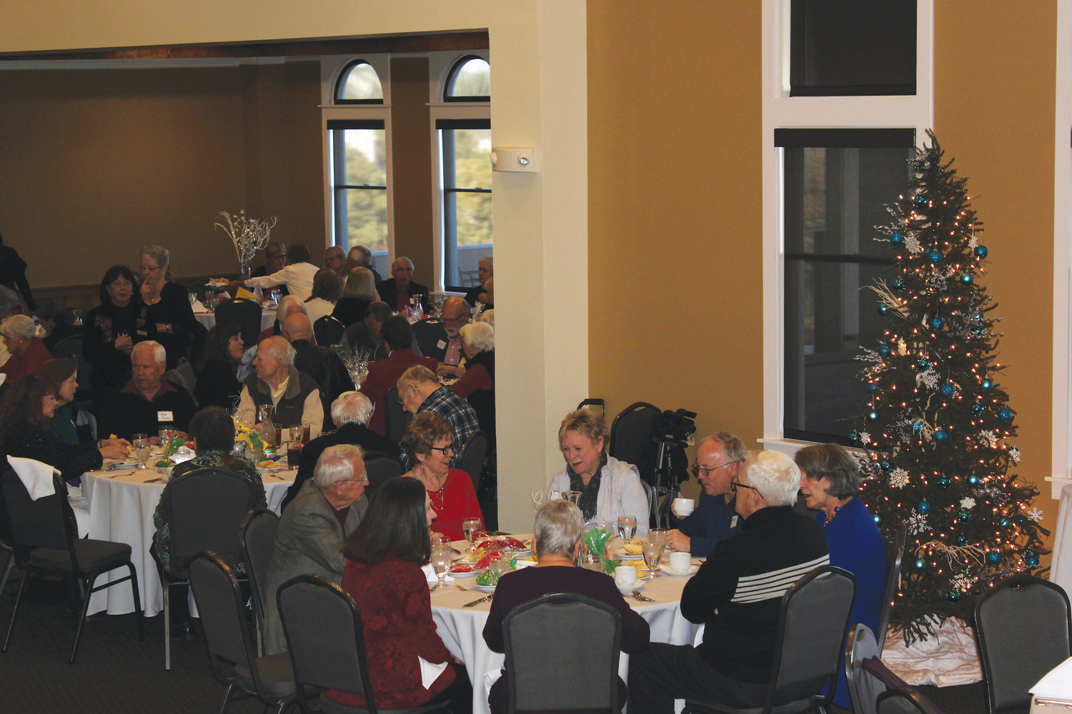Dozens of senior citizens gathered at the Lone Tree Country Club for the Lone Tree Living and Aging Well holiday luncheon.